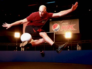 Daniel Cutting, Professional Football Freestyler and FIVE-TIME Guinness World Record Holder, performs at the launch of the Pepsi MAX Volley Arena in Essex. PRESS ASSOCIATION Photo. Picture date: Thursday April 21, 2016. Photo credit should read: Matt Alexander/PA Wire